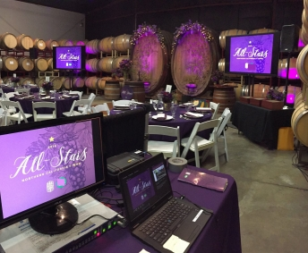 TV displays setup for dinner function at a San Francisco winery.