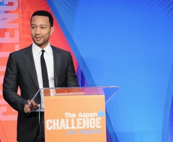John Legend giving speech at education conference in Los Angeles.