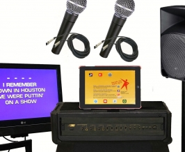 iPad- based karaoke system components, including monitor, iPad, microphones, speaker and mixer.