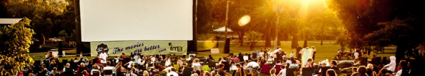 a large outdoor movie event at sunset.