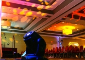 Indoor AV stage lighting and microphone setup at Doubletree Hotel Sales Conference.