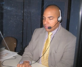 Spanish translator in booth.