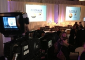 Video Camera pointed at two screens in a ballroom