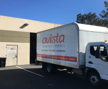 avista audio visual delivery truck in front of san francisco warehouse