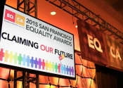 Stage display screen hanging over stage with lighting for 2015 San Francisco Equality Awards event.