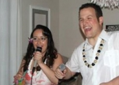 2 people singing into microphone at karaoke party.