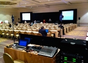 Indoor AV conference setup with sound and lighting display, projection screens, stage and podium at San Jose Fairmont Hotel Scientific Conference.