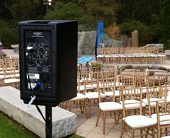 iPlay sound system QSC speaker set up by outdoor stage.