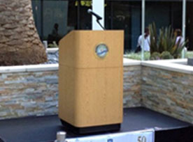 Outdoor wooden podium on stage outside of building