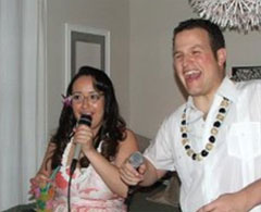 Woman and man sing karaoke.