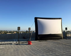 inflatable screen setup on rooftop of culver city building.