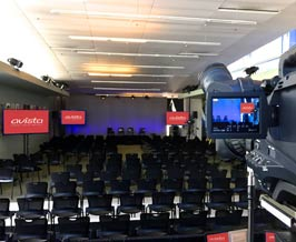 Large conference room with webcasting screens, cameras and equipment.